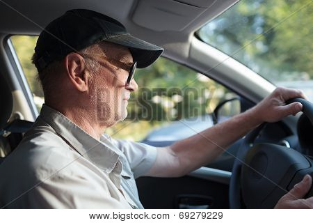 Senior man at the wheel