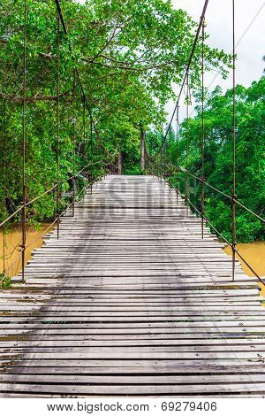 Old Wooden Long Rope Bridge Cross The Stream