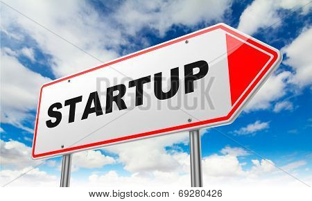 Startup on Red Road Sign.