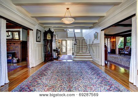 Luxury House. Hallway With Rug And Staircase