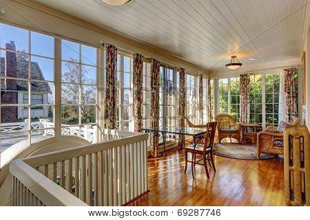 Bright Sunroom With Wicker Furniture