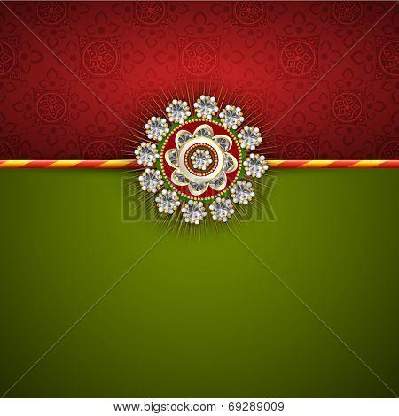 Beautiful white pearl decorated Rakhi on maroon and green background for Raksha Bandhan festival celebrations.
