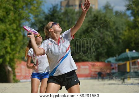 MOSCOW, RUSSIA - JULY 19, 2014: Woman double of Russia in the match against Italy during ITF Beach Tennis World Team Championship. Italy won in two sets
