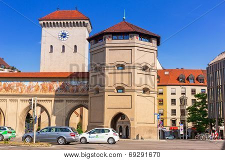 MUNICH, GERMANY - 19 JUNE 2014: The Isartor at the Isartorplatz in Munich, Germany. The Isartor is one of four main gates of the medieval city wall constructed in 1337.
