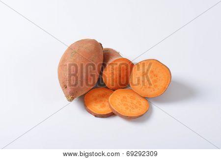 sliced sweet potatoes batatas on white background