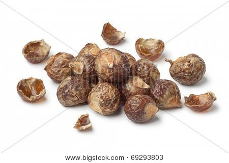 Nutshells of soapnuts on white background