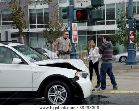 Highway Patrol Police Office Assist People After Their White Bmw Suv Is In An Accident