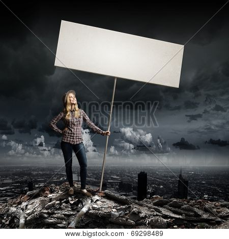 Young woman in casual carrying white blank banner