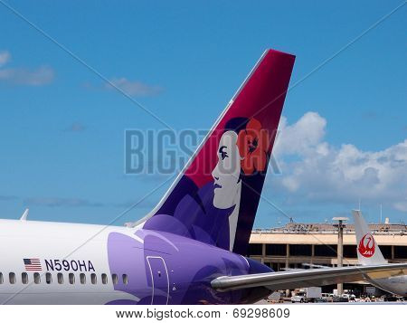 Tails Of Hawaiian Airlines And Japan Airlines Airplanes