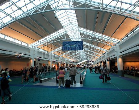 People Walk Throught The Portland Airport