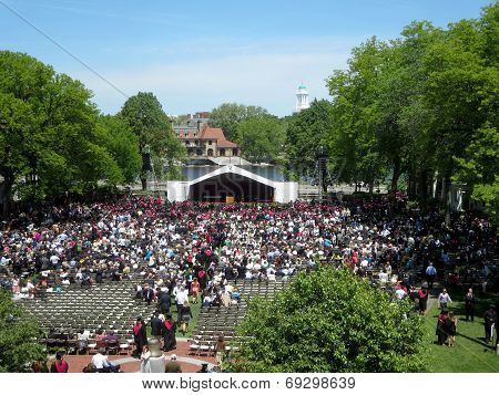 People Sit In Chairs As Harvard Business Students Of Harvard University Gather For Their Graduation