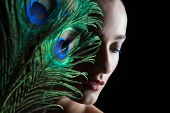 foto of female peacock  - Beautiful brunette young woman with peacock style make - JPG