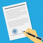 pic of contract  - picture of human hand holding an ink pen and signing contract or offer agreement - JPG
