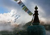 picture of dharma  - Buddhist Stupa with prayer flags and Thamserku peak  - JPG
