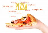 stock photo of take out pizza  - Slice of tasty pizza in hand - JPG
