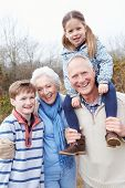 image of grandparent child  - Grandparents With Grandchildren On Walk In Countryside - JPG