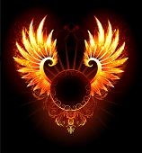 stock photo of art gothic  - artistically painted round banner with fiery phoenix wings on a black background - JPG