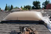 stock photo of roofs  - Demolition and removal of an Old Asphalt Single roof that was installed over an old Cedar Shake Roof from the 1960 - JPG