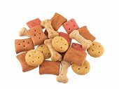 stock photo of biscuits  - Close up of assorted shaped dog biscuits on a white background - JPG