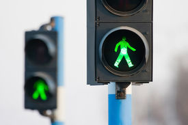 image of traffic rules  - Green lights for pedestrians on two semaphores in traffic - JPG