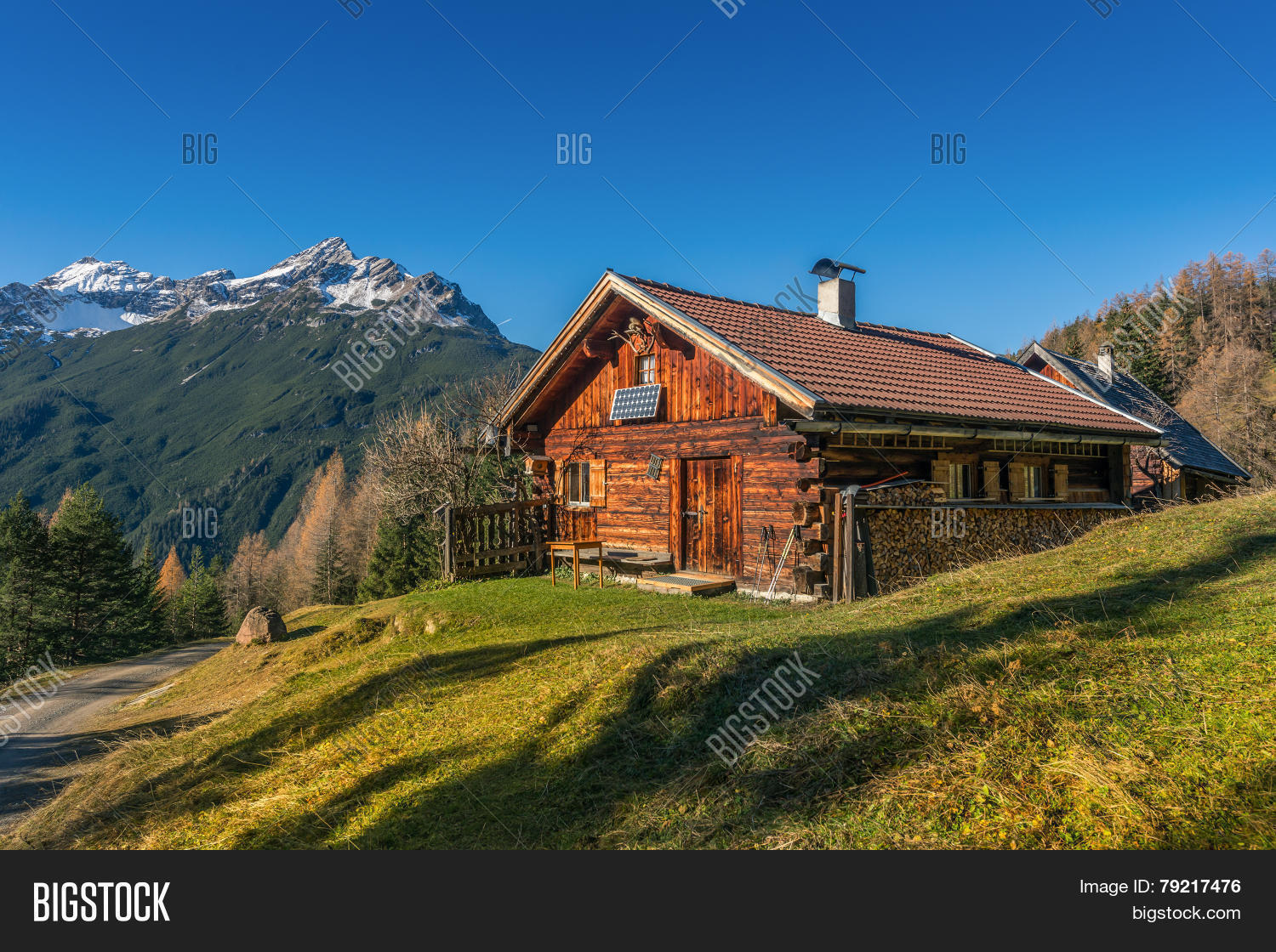 wooden hut near mountain -#main