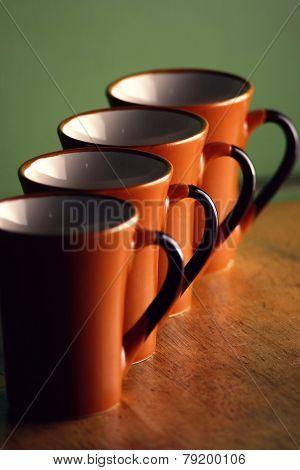 row of coffee mugs