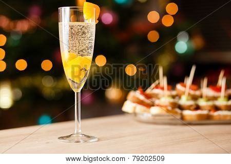 A glass of sparkling wine with apricot