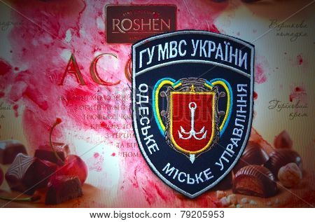Illustrative editorial. Chevron of Ukrainian Police in Odessa City.With logo Roshen Inc. Trademark Roshen is property of ukrainian president Poroshenko.At December 20,2014 in Kiev, Ukraine