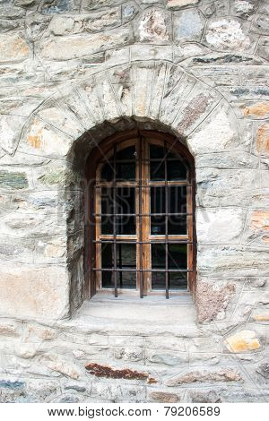Old Window On A Stone Wall