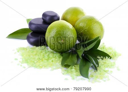 Fresh lime with sea crystals and stones isolated on white