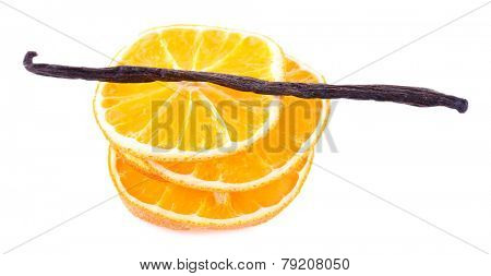 Pile of dried orange with vanilla bean isolated on white