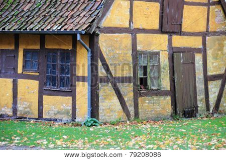 Old Worn Half-timbered Cottage House With Broken Window