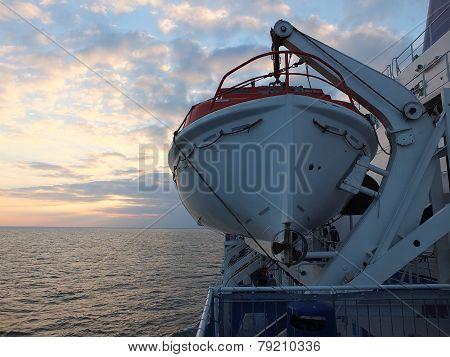 Life boats at sunset