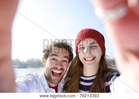 Young Couple Having Fun And Taking Selfie