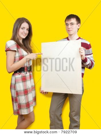 Smiling Girl And Men With Poster