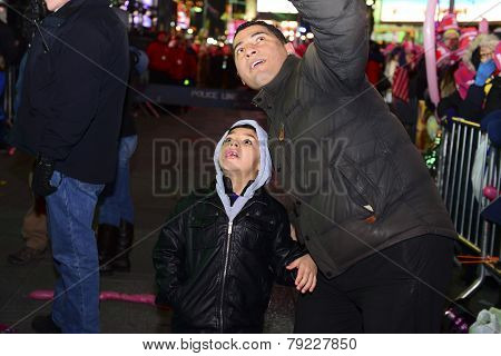 Father & son look at electronic display