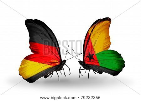 Two Butterflies With Flags On Wings As Symbol Of Relations Germany And Guinea Bissau