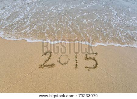 new year 2015 written in sand