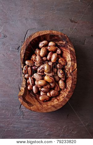 Pinto beans in an olive wood dish