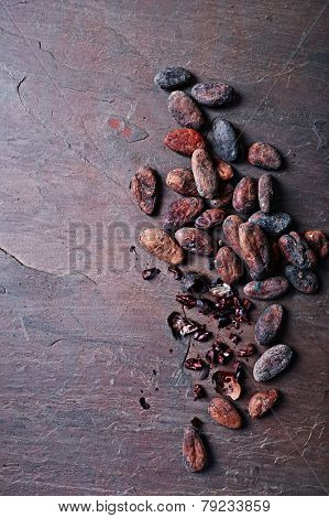 Cocoa beans on slate background