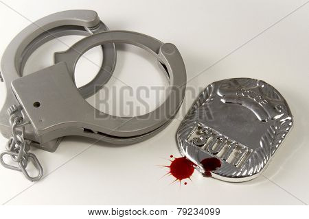 Blood Splattered Badge With Handcuffs