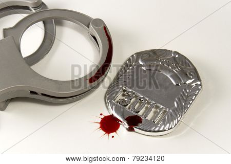 Bloody Badge And Handcuffs