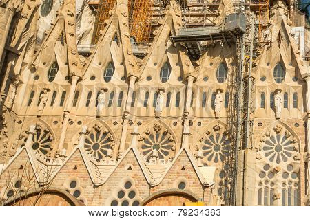 BARCELONA, SPAIN - DEC 23: Detail of a wall La Sagrada Familia - the impressive cathedral designed by Gaudi, which is being build since Mar 19, 1882 and is not finished yet.