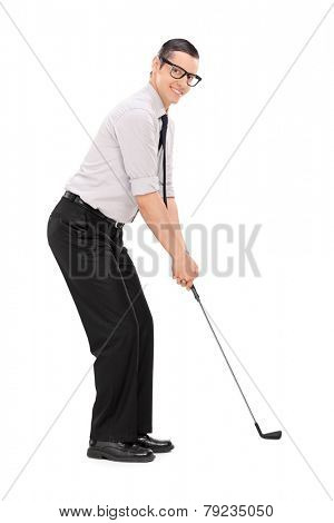 Full length portrait of a man playing golf isolated on white background
