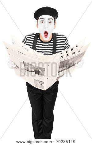 Street artist with newspaper making a grimace isolated on white background