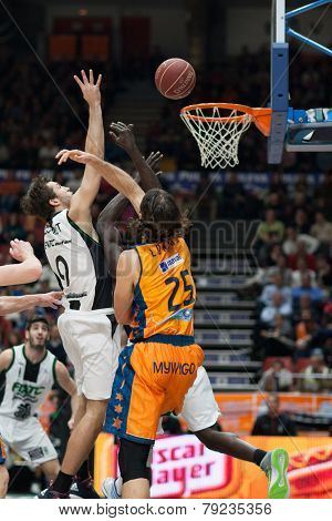 VALENCIA, SPAIN - DECEMBER 30: Llovet (9) and Loncar (25) during Spanish League match between Valencia Basket Club and Juventut at Fonteta Stadium on December 30, 2014 in Valencia, Spain