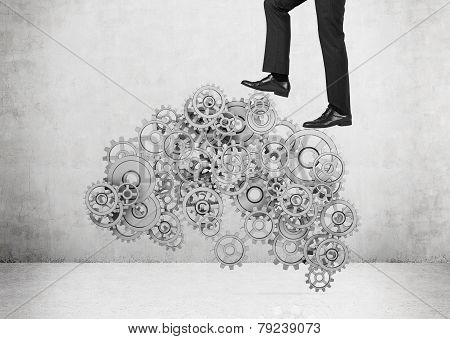 Businessman Walking On Gears