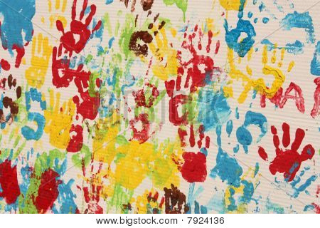 Handprints In Different Colors In A Mural.