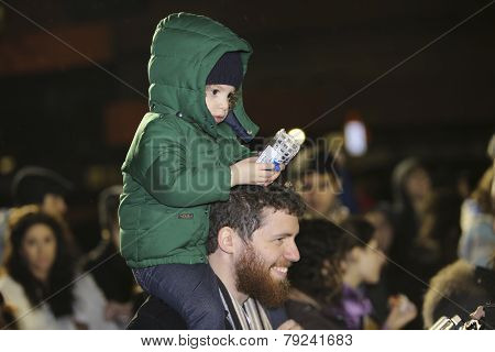 Child with Hanukah toy
