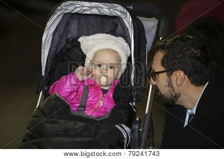 Baby with father prior to lighting